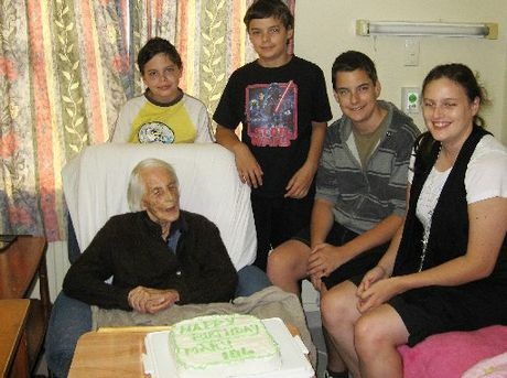 HAPPY: Mary Young with her great-grandchildren, Eli, Ezekiel, Micaiah and Emilee Gillies, and the birthday cake made by Emilee. PHOTO/JILL GILLIES