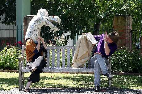 DRAGON PLAY: Mainstreet Wanganui's marketing manager Elise Goodge plays the dragon for Mainstreet's facilitator Geoff Follett in an impromptu rehearsal. PHOTO/STUART MUNRO