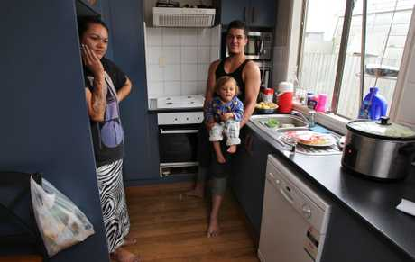 Tauranga couple Kyla Cox and Cruz Richmond with 2-year-old nephew Khyris Ruki are glad no one was hurt when a build up of gas ignited in an explosion behind their stove.