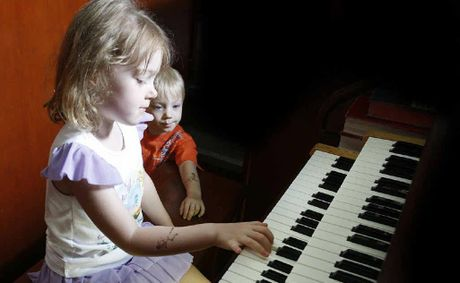 Classical organ students Poppy and Kip Colling show off their musical ability at Ipswich's Central Church.
