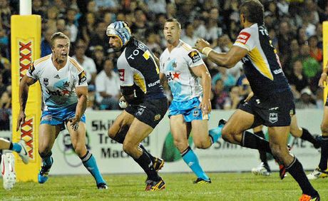 Cowboy Johnathan Thurston sets up a move in the NRL trial against the Gold Coast Titans in Mackay on Saturday.