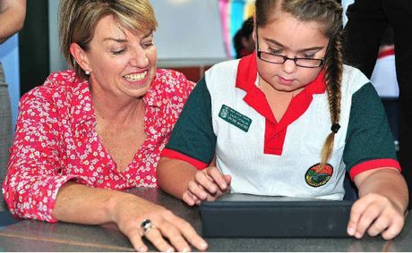 Anna Bligh joins Brydie Milburn, the school captain at Eimeo Road State School, who is working on a school iPad.
