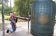 Lynn Collins and grandson Jake sounding the peace bell.