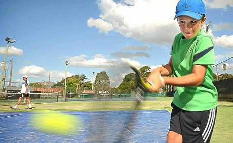 Grafton player Eli Fahey warms up in readiness for the Optus Junior Tour tennis tournament that gets underway at the Grafton Tennis Centre tomorrow.