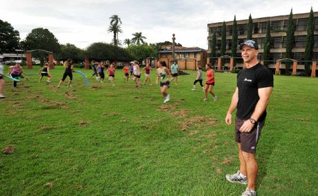 Craig Nipperess, of Xplode Personal Training, guides some of the Grafton Shoppingworld staff through its paces at Memorial Park.