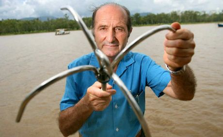 Franco Dallavalle holds up the anchor he has invented which folds up once the user is finished with it.