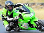 Mackay Kawasaki's Luke Burgess on the Ninja he rode to win the 250cc Production class at Phillip Island at the weekend. However, the event turned to tragedy in the Superstock 600cc race, when a rider was killed.