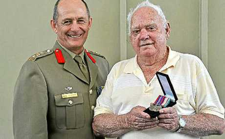 Beerwah veteran Doug Stevens has been presented with two war medals by Colonel Don Cousins.