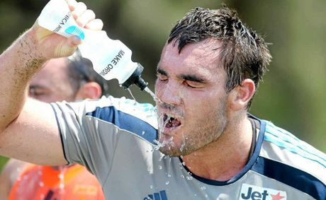 Gold Coast Titans' Luke Douglas after a gruelling training session in the heat.