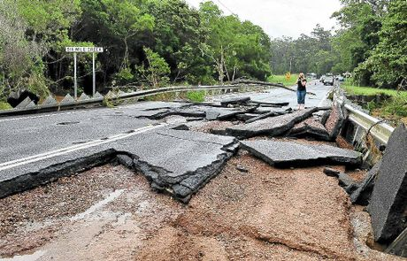 Elm St Cooroy at the Six Mile Creek Bridge is cut by floodwaters damaging the road.