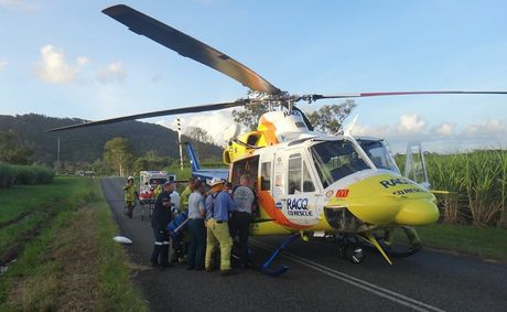 RACQ-CQ Rescue's crew prepares to airlift two men to hospital after this afternoon's crash at Koumala.