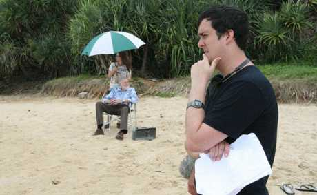Daley Pearson and Barry Crocker film The Strange Calls at Coolum Beach.