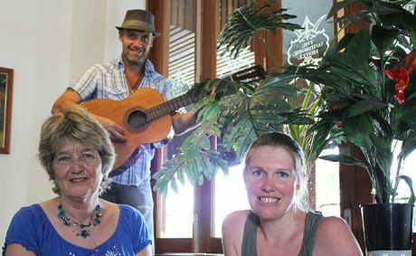 Lismore Soup Kitchen president Mieke Bell (left) and Sharon Dwyer with musician John Gift at the Winsome.