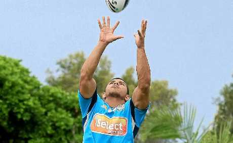 Gold Coast Titans winger David Mead leaps for a high ball during a training run at Ballina.