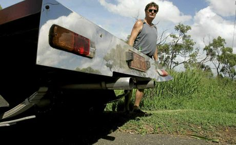 Mark Simpson with his Holden HQ ute which thieves tried to steal, before driving it off a retaining wall at his Koongal home.