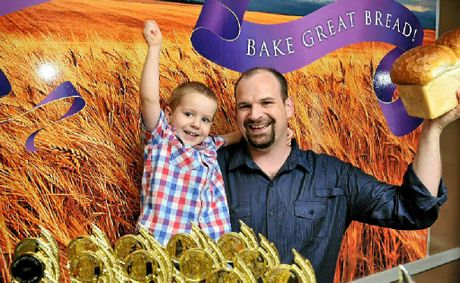 Owner of Born and Bread Bakery Brad Reeves celebrates his stores big win with son Ryan, 2.