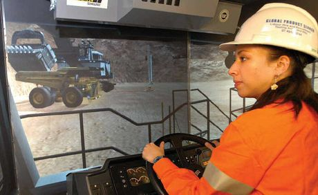 Kaylene Munro gains training as an operator on a simulator. The mining industry is looking to women as a solution to the skills shortage.