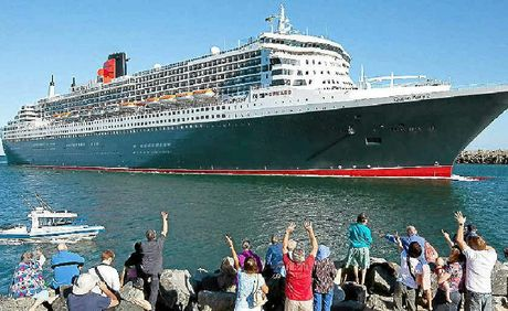 ATTENTION SEEKER: The Queen Mary 2 is the talk of the town with people clambering for a vantage point to see her regal beauty.
