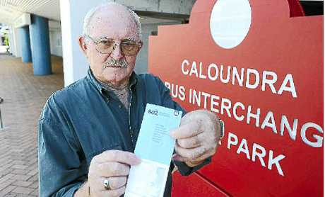 LET DOWN: Peter Jacobs with the bus timetable. Because of work he had to walk more than 1km back to hospital.