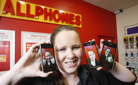Employee of Allphones Riverlink Jennifer Spence with the 3 most popular smart phones, the iPhone, Samsung and Sony Ericsson Arc.