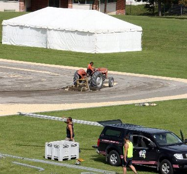 Tractor driver Hamish Dooney, from Phoenix Contracting, works on the comprehensively-designed temporary dressage arena made from crushed limestone and river sand at the Hawke's Bay show grounds in Hastings. PHOTOS/GLENN TAYLOR HBT121299-10
