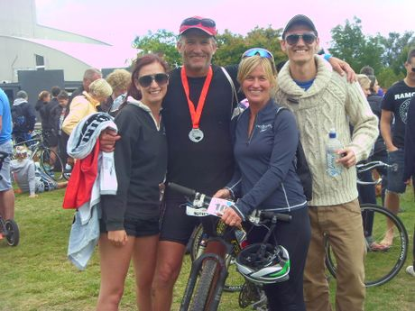 ALL OVER: Hawke's Bay Today deputy editor Grant Harding with his niece Stefanie, Janet Pease-Watkin, and Stefanie's boyfriend, CJ, following the Ironman New Zealand 2012 Half-Ironman last Sunday.