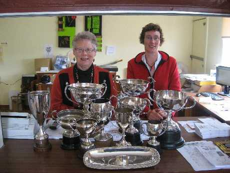 North Otago A&P; Show secretary Barbara Watt (left), assisted by Lois Miles, cleans some of the trophies in readiness for the show classes.