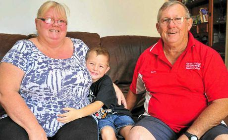 Christene and Wayne Bowers, seen with grandson Kael, 6, both quit smoking while under hypnosis.