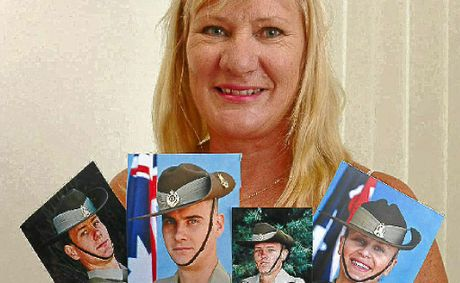 Alison Bonner with photos of her children (L-R) Sgt Shane McPhee, Saper Darren McPhee, Private Nick McPhee and Private Lauren McPhee.