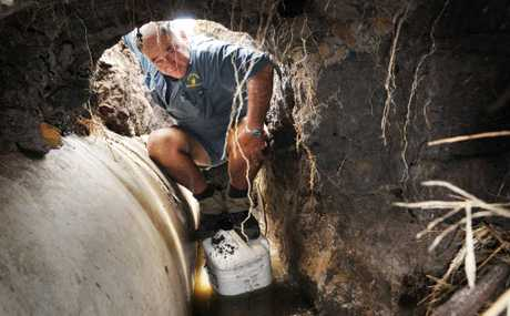 "ROAD TOLL: Peter Buchanan stands ""in"" one of his main on-farm road culverts destroyed by floodwaters last week."