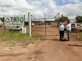 A GROUP of workers gathered in front of a Moranbah industrial site Tuesday morning, where, just hours earlier, an explosion claimed the life of a young father.