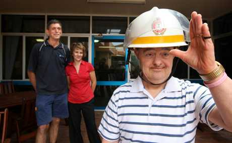 Alan Bartlett and Barbara Tsakmakis are excited about fire fighting die-hard Trevor Bale's birthday visit from the Tugun Fire Station.