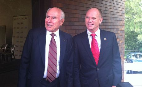 ''He will win''... former Prime Minister John Howard with Campbell Newman in Brisbane this morning.