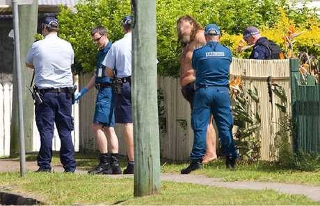 LOCKDOWN: Suburb in siege at Norman St in Basin Pocket on Friday morning. Photo: Rob Williams