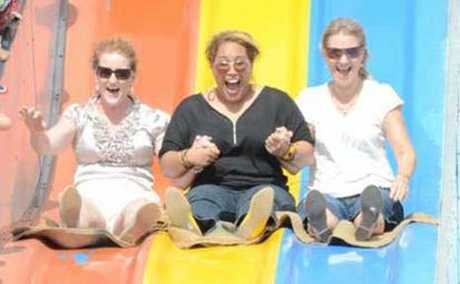 SLIP AND SLIDE: Jacqui Pressey, Sela Tuavao and Tammy Malings enjoy the days celebrations.