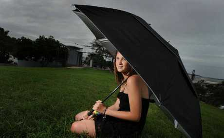 WEATHER WATCH: Annika Cutler, 16, is enjoying the much cooler weather in Gladstone even though there is no sunshine.