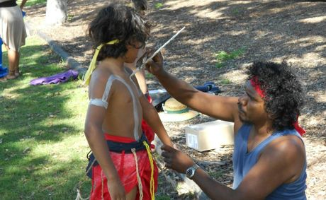 Facilitator Dennis Duncan bonds with son Doai during the new after school program. Photo: supplied
