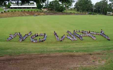 TAKING A STAND: Year 7 students at John Paul College spelt out the words no way for say no to bullying day.