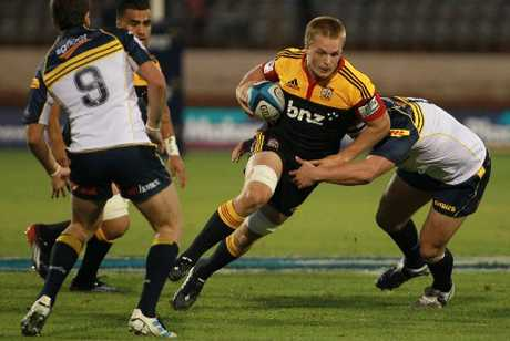 Chiefs&#39; Sam Cane looks for a way through the Brumbies&#39; defensive line during their 29-22 win at Bay Park. Photo / Joel Ford