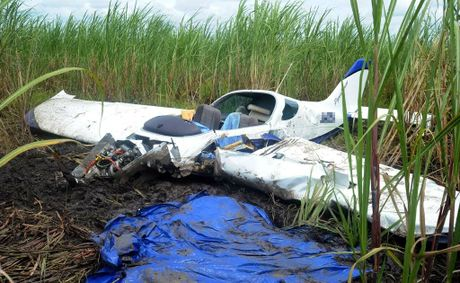 Two men died after their plane crashed in a cane field near Fairymead Mill.