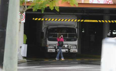A shopper at Grafton Shoppingworld takes a quick snap of a truck stuck in the undercover carpark. Photo: Adam Hourigan / The Daily Examiner