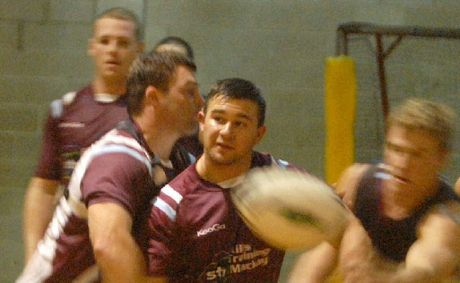 Mackay Cutters Neil Budworth, Kelvin Nielsen and Chris Gesch train inside at Mackay State High School, due to heavy rain.