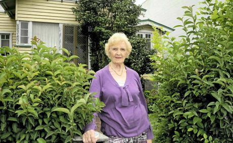 SAD FAREWELL: Erin McKittrick, 89, visited her family home Eurongella perhaps for the final time yesterday. Council could have the house removed by as early as tomorrow.