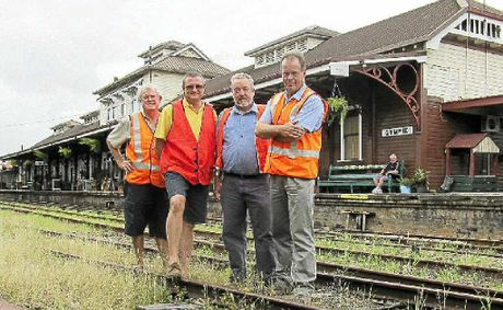 MVHR committee member Geoff Webber, secretary Len Tighe, general manager Jim Walker and president Tony Hallam at Gympie's historic railway station.