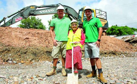 Damian, left, and Aaron Miller, of Vynara, with Esme Tait, turn the first sod of soil on site at Tait's Corner, Tewantin.