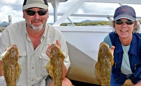 Robbie and Lesley Willcox caught flathead in the river.