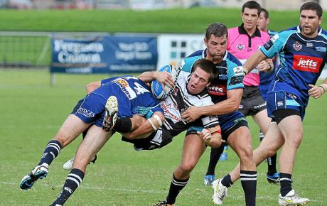 Tweed Heads Tom Merritt is heavily tackled by Sea Eagles Kane Richards and Mitchell Buckett at Stockland Park.