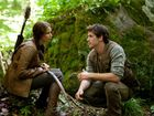 Jennifer Lawrence and Liam Hemsworth in a scene from the movie The Hunger Games.
