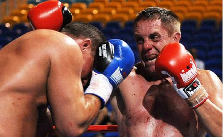 Robert Glasson-Wilesmith (right) keeps Mike Sheppard of the USA at bay during the IKF world heavyweight kickboxing title bout at Skilled Park on the Gold Coast.