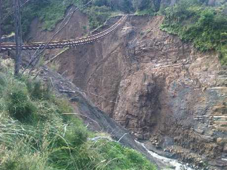 A washout north of Wairoa left railway tracks hanging in the air.